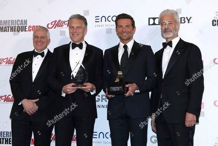 Stock Image of Mark Badagliacca, Doug Darrow, Bradley Cooper, Rick Nicita. Mark Badagliacca, American Cinematheque President, from left, Doug Darrow, Senior Vice President, Cinema Business Group, Dolby Laboratories, with the Sid Grauman Award, Bradley Cooper, with the American Cinematheque award and Rick Nicita, Chairman, American Cinematheque are seen at the American Cinematheque Awards at the Beverly Hilton, in Beverly Hills, Calif