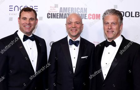 Stock Photo of David Dolby, Kevin Yeaman, Doug Darrow. David Dolby, from left, Kevin Yeaman, President and CEO, Dolby Laboratories, and Doug Darrow, Senior Vice President, Cinema Business Group celebrate the American Cinematheque Awards honoring Bradley Cooper and Dolby on at the Beverly Hilton in Beverly Hills, Calif