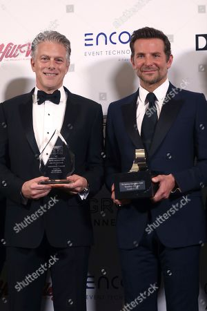 Bradley Cooper, Doug Darrow. Bradley Cooper, right, and Doug Darrow, Senior Vice President, Cinema Business Group, Dolby Laboratories, accept American Cinematheque and Sid Grauman Awards, respectively, at the American Cinematheque Awards on at the Beverly Hilton, in Beverly Hills, Calif