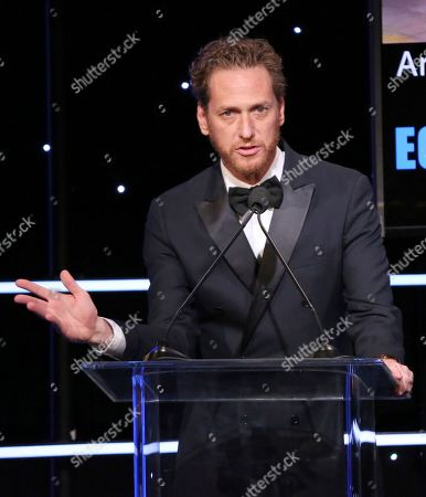Stock Picture of Brian Klugman speaks at the American Cinematheque Award ceremony honoring Bradley Cooper, at the Beverly Hilton Hotel in Beverly Hills, Calif