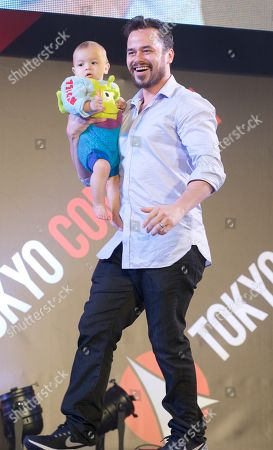 Stock Photo of Daniel Logan and with his baby
