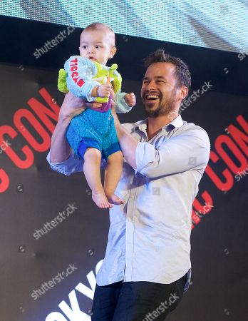 Stock Image of Daniel Logan and with his baby