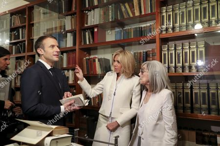 Stock Picture of French President Emmanuel Macron (L) and First Lady Brigitte Trogneux speak with the widow of the late Argentine writer Jorge Luis Borges, Maria Kodama (R) during a visit to the Jorge Luis Borges international foundation in Buenos Aires