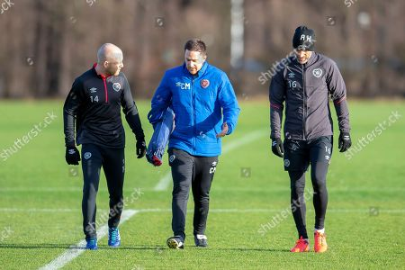 Steven Naismith (#14) of Heart of Midlothian chats with physio Craig Maitland (centre) and Aaron Hughes (#16) of Heart of Midlothian, at Oriam Sports Performance Centre, Riccarton, Scotland on 30 November 2018