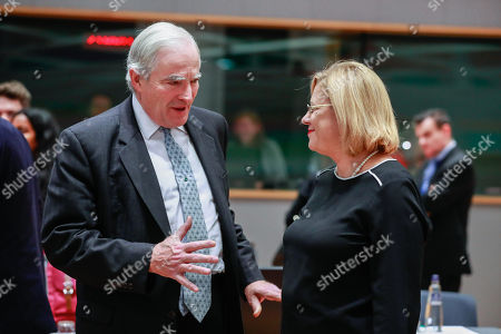 Stock Photo of Britsh Parliamentary Under Secretary of State for Department for Business, Energy and Industrial Strategy Oliver Eden, Lord Henley (L) and European Commissioner for Regional Policy, Corina Cretu at the start of a  General Affairs Council meeting on cohesion at the European Council in Brussels, Belgium, 30 November 2018.