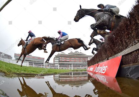 (R) Santini (Nico de Boinville) follows the field over the water jump before going on to win The Ladbrokes John Francome Novices Steeple Chase.