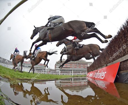 (nearest camera) Santini (Nico de Boinville) follows the field over the water jump before going on to win The Ladbrokes John Francome Novices Steeple Chase.
