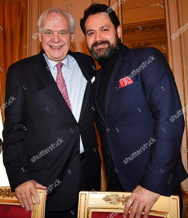 Austrian superintendent of the Teatro alla Scala Alexander Pereira (L) and the Russian bass Ildar Abdrazakov pose at a press conference to present 'Attila', the Giuseppe Verdi opera that will open the new season of the Teatro alla Scala opera house, in Milan, Italy, 30 November 2018. The opera production will be staged from 07 December 2018 to 08 January 2019.