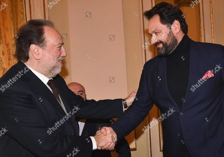 Italian conductor Riccardo Chailly (L) shakes hands with Russian bass Ildar Abdrazakov at a press conference to present 'Attila', the Giuseppe Verdi opera that will open the new season of the Teatro alla Scala opera house, in Milan, Italy, 30 November 2018. The opera production will be staged from 07 December 2018 to 08 January 2019.
