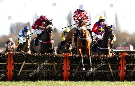 BRIGHT FORECAST (blue cap, left, Nico De Boinville) comes from an impossible position at the last to catch the leader SEVARANO (Leighton Aspell) in The Ladbrokes National Hunt Maiden Hurdle Newbury