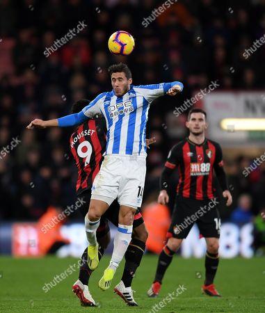 Ramadan Sobhi of Huddersfield Town heads the ball