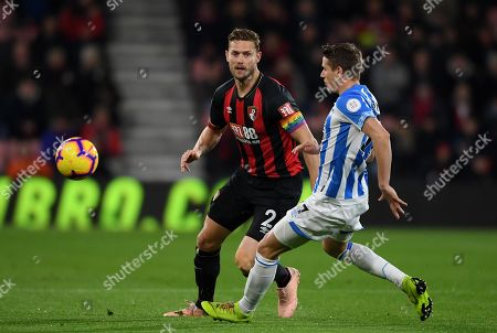 Simon Francis of Bournemouth  gets past Eric Durm of Huddersfield Town