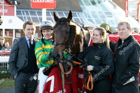 Sir Anthony McCoy, Barry Geraghty and JP McManus with Unowhatimeanharry after victory in the Ladbrokes Long Distance Hurdle at Newbury.