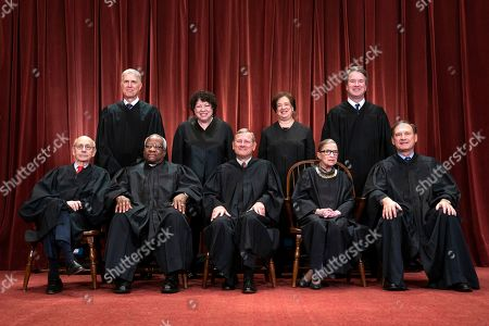 United States Chief Justice John G. Roberts (F-C), along with Supreme Court Associate Justices Stephen Breyer (F-L), Clarence Thomas (F-2-L), Ruth Bader Ginsburg (F-2-R), Samuel Alito, Jr. (F-R), Neil Gorsuch (B-L), Sonia Sotomayor (B-2-L), Elena Kagan (B-2-R), and Brett M. Kavanaugh (B-R) pose for an official group portrait in the East Conference Room of the Supreme Court in Washington, DC, USA, 30 November 2018. On 06 October 2018, after a bitterly contentious nomination fight, Brett Kavanaugh became the 114th Justice of the Supreme Court.