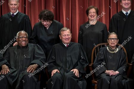 Clarence Thomas, John G. Roberts, Ruth Bader Ginsburg, Samuel Alito Jr., Neil Gorsuch, Sonia Sotomayor, Elena Kagan, Brett M. Kavanaugh. Smiles come across the faces of several justices of the U.S. Supreme Court at the end of a formal photo session, at the Supreme Court Building in Washington, . Seated from left: Associate Justice Clarence Thomas, Chief Justice of the United States John G. Roberts, and Associate Justice Ruth Bader Ginsburg. Standing behind from left: Associate Justice Neil Gorsuch, Associate Justice Sonia Sotomayor, Associate Justice Elena Kagan and Associate Justice Brett M. Kavanaugh