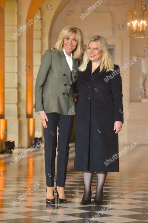 French First Lady Brigitte Trogneux and Israel's First Lady Sara Ben-Artzi at Chateau De Versailles