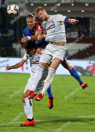 Matthew Mills, right, of FC Pune City heads the ball in an attempt to score a goal during the Hero Indian Super League (ISL) soccer match between Bengaluru FC and FC Pune City in Bangalore, India