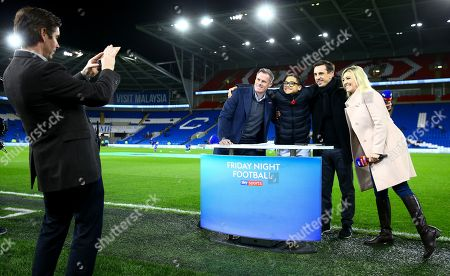 A young fan manages to get a picture with the Sky Sports team of Jamie Carragher, Gary Neville and Kelly Cates