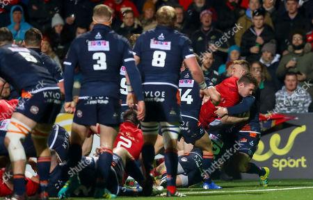 Munster vs Edinburgh. Munster's Chris Farrell scores a try despite Dougie Fife of Edinburgh