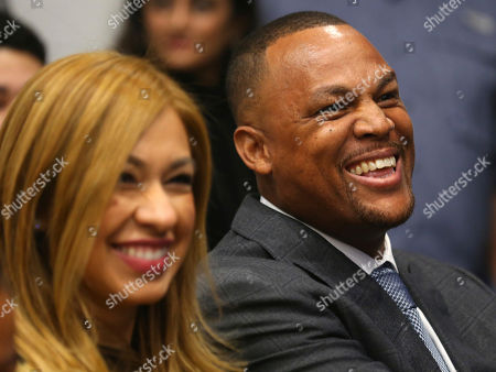 Adrian Beltre laughs with his wife Sandra before being introduced in Arlington, Texas, . Beltre, who spent the last eight seasons of his Hall of Fame-caliber career with the Texas Rangers, formally said goodbye in a laugh-filled news conference at the ballpark where the four-time All-Star and five-time Gold Glove third baseman joined the 3,000-hit club in 2017