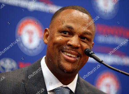 Adrian Beltre smiles at a news conference in Arlington, Texas, . Beltre, who spent the last eight seasons of his Hall of Fame-caliber career with the Texas Rangers, formally said goodbye in a laugh-filled news conference at the ballpark where the four-time All-Star and five-time Gold Glove third baseman joined the 3,000-hit club in 2017