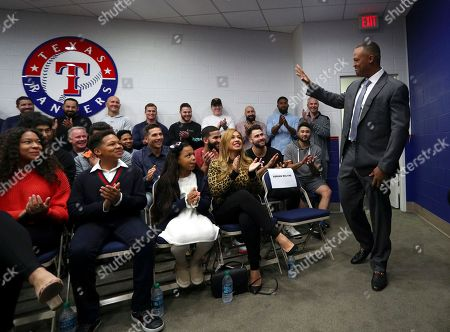 Adrian Beltre gestures to family and former and current players at a news conference in Arlington, Texas, . Beltre, who spent the last eight seasons of his Hall of Fame-caliber career with the Texas Rangers, formally said goodbye in a laugh-filled news conference at the ballpark where the four-time All-Star and five-time Gold Glove third baseman joined the 3,000-hit club in 2017