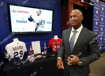Adrian Beltre leaves a news conference in Arlington, Texas, . Beltre, who spent the last eight seasons of his Hall of Fame-caliber career with the Texas Rangers, formally said goodbye at a news conference at the ballpark where the four-time All-Star and five-time Gold Glove third baseman joined the 3,000-hit club in 2017