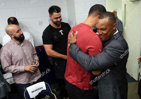 Adrian Beltre, right, gets a hug from Nomar Mazara after a news conference in Arlington, Texas, . Beltre, who spent the last eight seasons of his Hall of Fame-caliber career with the Texas Rangers, formally said goodbye in a laugh-filled news conference at the ballpark where the four-time All-Star and five-time Gold Glove third baseman joined the 3,000-hit club in 2017