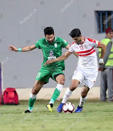 Zamalek SC player Ferjani Sassi (R) in action against Al Ittihad Alexandria player Karim ElDeib (L) during the Zayed Club Champions Cup game between Zamalek SC and Al Ittihad Alexandria, in Cairo, Egypt, 30 November 2018.