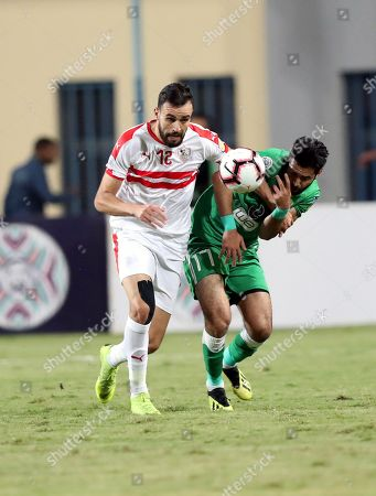 Zamalek SC player Hamdi Nagguez (L) in action against Al Ittihad Alexandria player  Karim Eldieb (R) during the Zayed Club Champions Cup game between Zamalek SC and Al Ittihad Alexandria, in Cairo, Egypt, 30 November 2018.