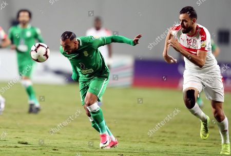Zamalek SC player Hamdi Nagguez (R) in action against Al Ittihad Alexandria player  Khaled Kamer (L) during the Zayed Club Champions Cup game between Zamalek SC and Al Ittihad Alexandria, in Cairo, Egypt, 30 November 2018.