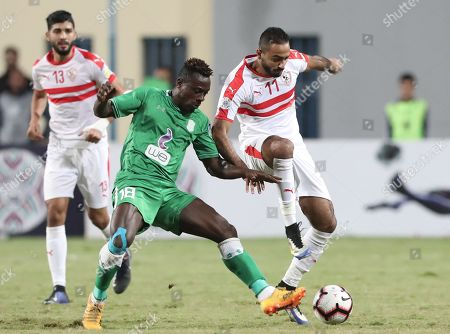 Zamalek SC player Kahraba   (R) in action against Al Ittihad Alexandria player Emmanuel Banahene (L) during the  Zayed Club Champions Cup game between Zamalek SC and Al Ittihad Alexandria, in Cairo, Egypt, 30 November 2018.