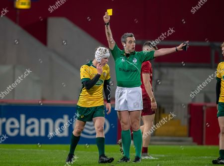 Munster U19's vs Australia Schools. Referee Richard Horgan shows a yellow card to John Connolly of Australia Schools