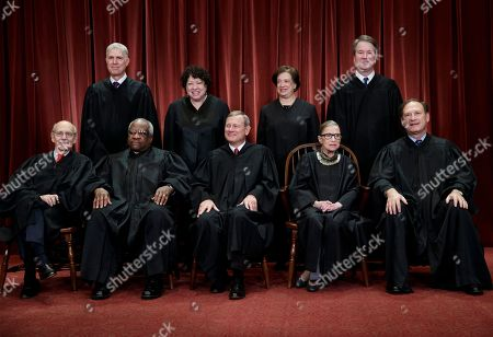 The justices of the U.S. Supreme Court gather for a formal group portrait to include new Associate Justice, top row, far right, at the Supreme Court Building in Washington, . Seated from left: Associate Justice Stephen Breyer, Associate Justice Clarence Thomas, Chief Justice of the United States John G. Roberts, Associate Justice Ruth Bader Ginsburg and Associate Justice Samuel Alito Jr. Standing behind from left: Associate Justice Neil Gorsuch, Associate Justice Sonia Sotomayor, Associate Justice Elena Kagan and Associate Justice Brett M. Kavanaugh