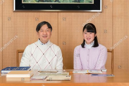 In this Nov. 25, 2018, photo provided by the Imperial Household Agency of Japan, Japan's Princess Aiko poses with her father Crown Prince Naruhito for a photo, at Togu Palace in Tokyo. Princess Aiko, daughter of Crown Prince Naruhito and Crown Princess Masako, celebrated 17th birthday on