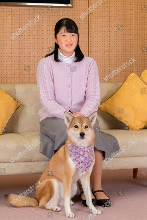 Stock Photo of In this Nov. 25, 2018, photo provided by the Imperial Household Agency of Japan, Japan's Princess Aiko poses for a photo with her pet dog Yuri, at Togu Palace in Tokyo. Princess Aiko, daughter of Crown Prince Naruhito and Crown Princess Masako, celebrated 17th birthday on