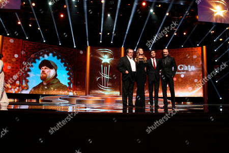 Julian Schnabal, Louise Kugelberg. Director Julian Schnabel, left, and screenwriter Louise Kugelberg, second left, attend the screening of the film 'At Eternity's Gate' during the Opening Ceremony at the 17th Marrakech International Film Festival in Marrakech, Morocco, . The festival runs from Nov. 30 - Dec.8