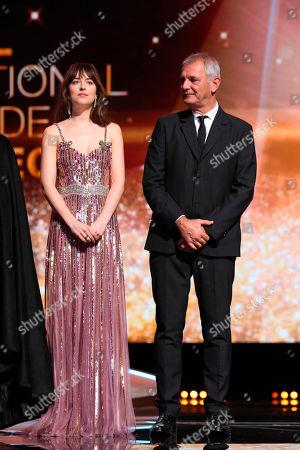 Dakota Johnson, Laurent Cantet. Dakota Johnson, left, and Laurent Cantet attend 17th Marrakech International Film Festival Opening Ceremony in Marrakech, Morocco, . The festival runs from Nov. 30 - Dec.8