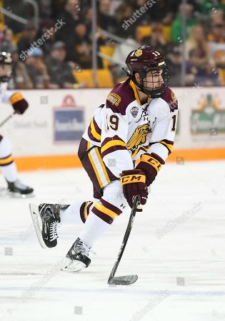 Minnesota-Duluth Bulldogs forward Justin Richards (19) skates the puck up ice durin a NCAA men's ice hockey game between the University of North Dakota Fighting Hawks and the Minnesota Duluth Bulldogs at Amsoil Arena in Duluth, MN. Minnesota Duluth won 5-0
