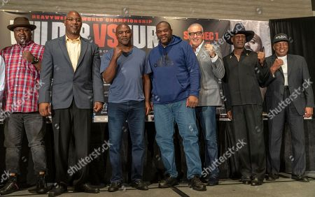 Stock Picture of Michael Spinks,Buster Douglas,Earnie Shavers,Lennox Lewis,Gerry Cooney,Riddick Bowe,Evander Holyfield. Former heavyweight champions, from left, Buster Douglas, Lennox Lewis, Evander Holyfield, Riddick Bowe, Gerry Cooney, Michael Spinks and Earnie Shavers pose for a photo in Los Angeles