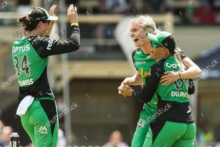 Stock Image of Holly Ferling of Melbourne Stars celebrates a wicket with Mignon du Preez of Melbourne Stars  and Georgia Elwiss during the Melbourne Stars vs Sydney Sixers Women's Big Bash League match at the CitiPower Centre, St.Kilda, Melbourne. Picture by Martin Keep