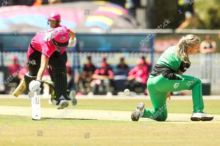 Stock Picture of Ellyse Perry (c) of Sydney Sixers runs between the wickets while Holly Ferling of Melbourne Stars attempts to gather the ball during the Melbourne Stars vs Sydney Sixers Women's Big Bash League match at the CitiPower Centre, St.Kilda, Melbourne. Picture by Martin Keep
