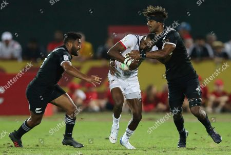 Stock Picture of Luke Masirewa, Perry Baker. New Zealand's Luke Masirewa tries to stop U.S. Perry Baker during the final match of the Emirates Airline Rugby Sevens in Dubai, the United Arab Emirates