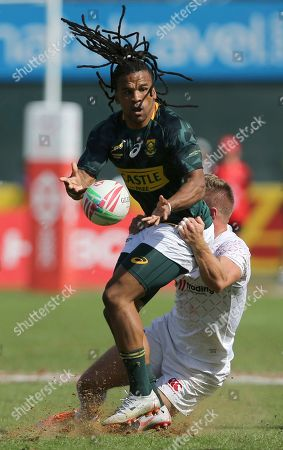 Tom Mitchell, Rosko Specman. England's captain Tom Mitchell tries to stop South Africa's Rosko Specman in a quarterfinal match of the Emirates Airline Rugby Sevens in Dubai, the United Arab Emirates