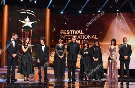 Jury members, German actor Daniel Bruehl, Lebanese filmmaker Joana Hadjithomas, Mexican filmmaker Michel Franco, Indian actress Ileana D'Cruz, US director James Gray, Scottish director Lynne Ramsay, Moroccan filmmaker Tala Hadid, US actress Dakota Johnson and French director Laurent Cantet on stage as they attend the Opening Ceremony of the 17th annual Marrakech International Film Festival, in Marrakech, Morocco, 30 November 2018 (issued 01 December 2018). The festival runs from 30 November to 08 December.