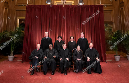 The Supreme Court Justices pose for their official group portrait in the Supreme Court in Washington, D.C. Seated from left: Associate Justice Stephen Breyer, Associate Justice Clarence Thomas, Chief Justice John G. Roberts, Associate Justice Ruth Bader Ginsburg and Associate Justice Samuel Alito, Jr. Standing behind from left: Associate Justice Neil Gorsuch, Associate Justice Sonia Sotomayor, Associate Justice Elena Kagan and Associate Justice Brett M. Kavanaugh.