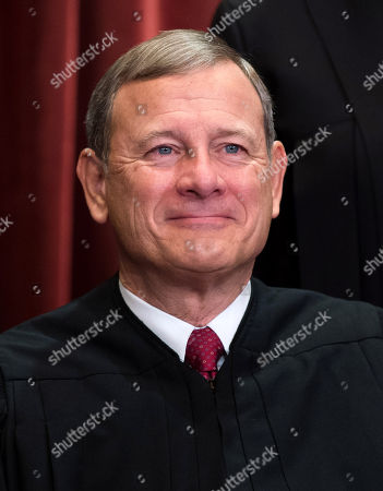 Chief Justice of the United States John G. Roberts, Jr. poses during the official Supreme Court group portrait at the Supreme Court in Washington, D.C.
