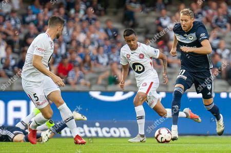 Melbourne Victory forward Ola Toivonen (11) runs the ball towards goal