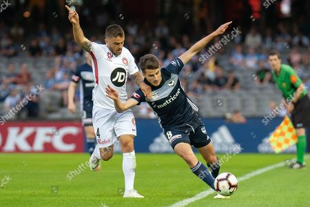 Melbourne Victory midfielder Terry Antonis (8)  competes for the ball against Western Sydney Wanderers defender Josh Risdon (4)