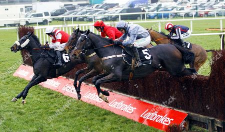 Santini and Nico De Boinville [near] jumps with Skipthecuddles before victory in the Ladbrokes John Francome Novices' Chase at Newbury.